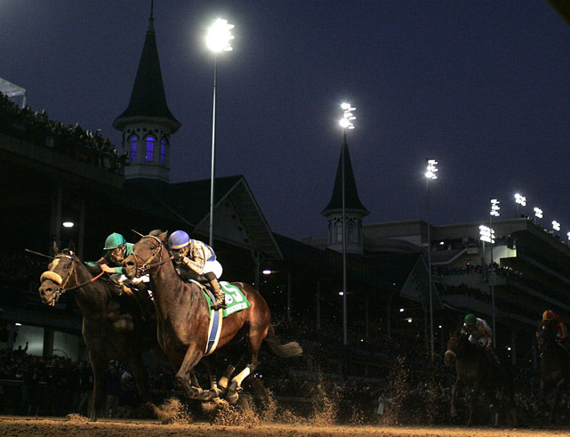 Jockey Garrett Gomez rides Blame to edge out Zenyatta (left), with jockey Mike Smith aboard, in the Classic race under the lights during the 2010 Breeders' Cup World Championships at Churchill Downs Nov. 6 in Louisville.