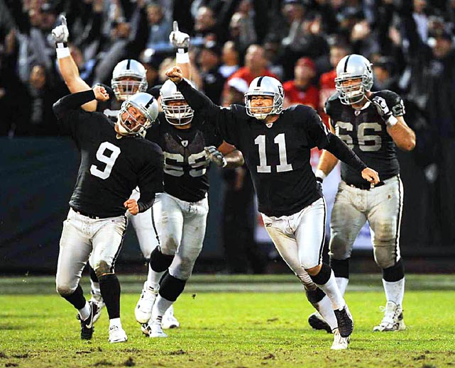 Oakland Raiders placekicker Sebastian Janikowski (11) celebrates with teammates after scoring the winning field goal in overtime to defeat  the Kansas City Chiefs 23-20.
