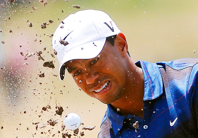 Tiger Woods plays out of a bunker on the sixth hole during the second round of the Australian Masters at the Victoria Golf Club on Nov. 12 near Melbourne. Woods finished in fourth to winner Stuart Appleby.