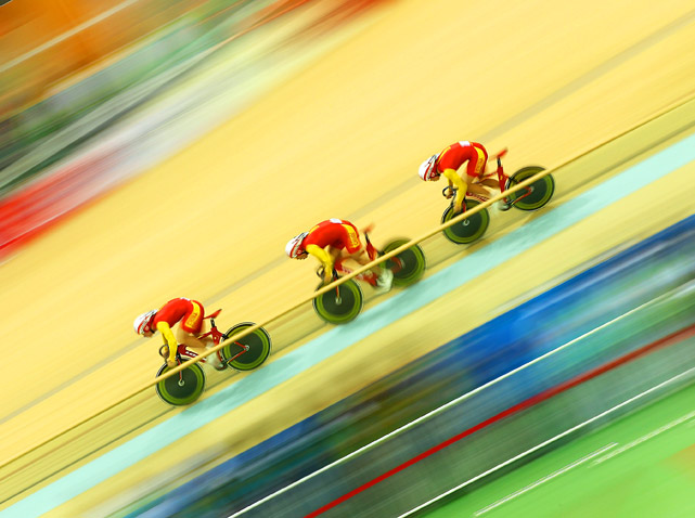 Team China sped down the velodrome track on its way to taking the gold medal in the cycling men's team sprint final Nov. 14 at the 16th Asian Games in Guangzhou, China.