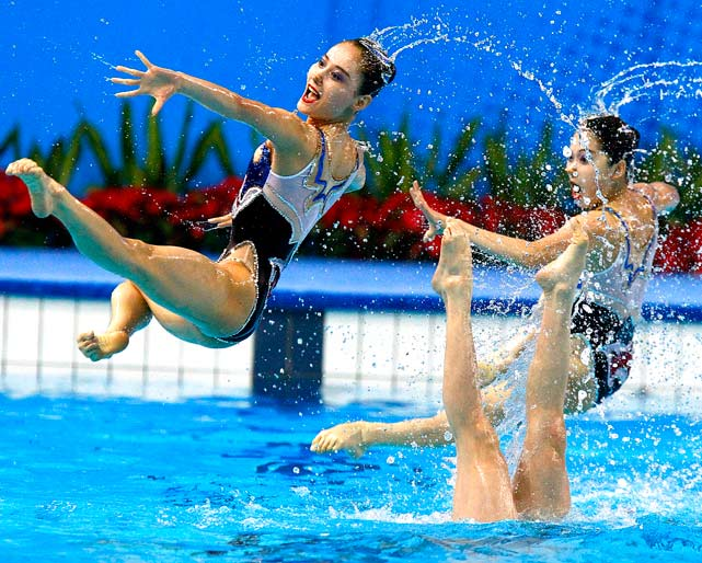 Members of the North Korean synchronised swimming team perform during the free routine competition at the 16th Asian Games.