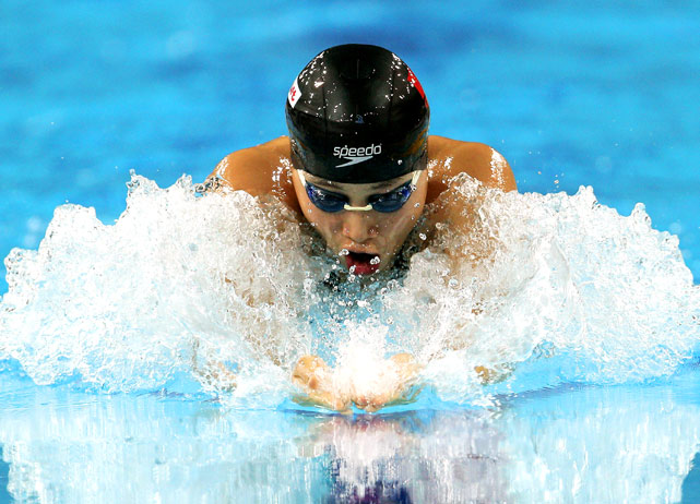 Liping Ji of China competes in a 100m Breaststroke heat at the Aoti Aquatics Centre during day four of the 16th Asian Games.