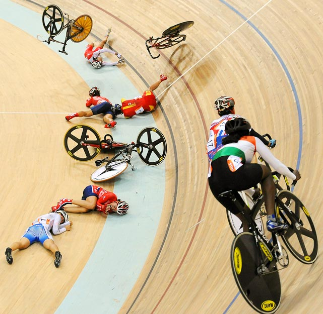 Riders try to avoid the five race leaders who crashed heavily on the corner during the women's points race cycling at the 16th Asian Games on November 16. Liu Xin from China emerged from the chaos with the gold medal.
