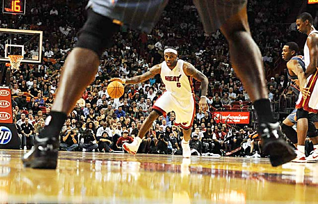 Miami Heat forward LeBron James brings the ball upcourt against the Charlotte Bobcats November 19 at the American Airlines Arena in Miami. The Heat defeated the Bobcats 95-87.