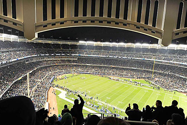 Fans in the upper deck cheered for Army and Notre Dame during the first college football game held in the new Yankee Stadium.