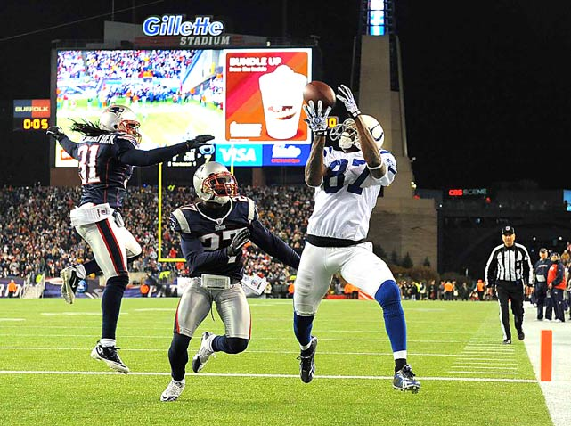 Indianapolis Colts wide receiver Reggie Wayne makes a touchdown catch during the first half against New England Patriots cornerback Kyle Arrington on November 21 at Gillette Stadium in Foxboro. New England defeated Indianapolis 31-28.