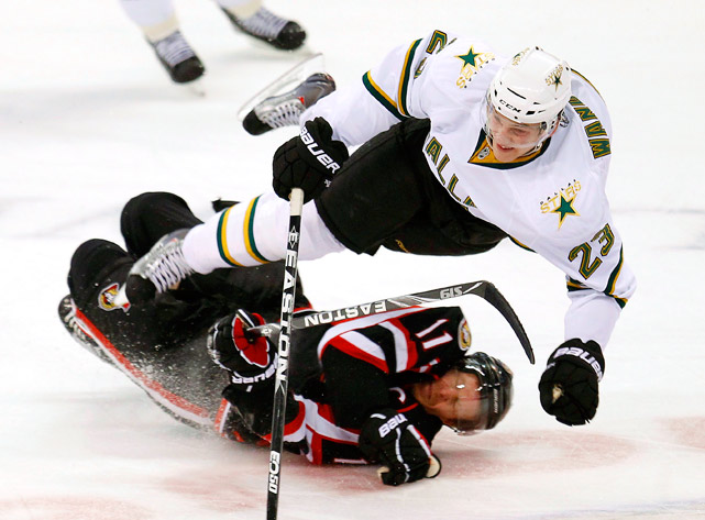 Dallas Stars center Tom Wandell trips over Ottawa Senators right wing Daniel Alfredsson during their Nov. 24 game in Ottawa. Wandell had two shots on goal as the Stars defeated the Senators 2-1.