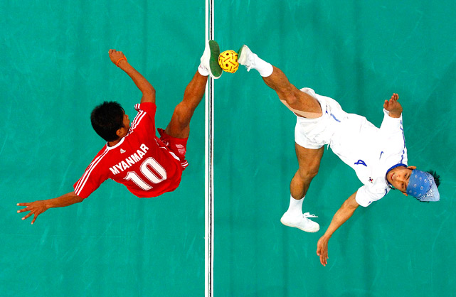 South Korea's Lee Jun-ho (right) challenges Myanmar's Zaw Zaw Aung at the net during their double sepak takraw final at the 16th Asian Games Nov. 27 in Guangzhou, China.