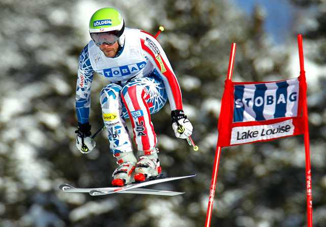 U.S. skier Bode Miller speeds past a gate during alpine skiing at the World Cup downhill in Lake Louise, Alberta, Nov. 27.  Miller finished 8th.