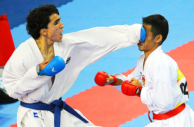 Bashar Al Najjar of Jordan lands a left to Donny Dharmawan of Indonesia in their 60KG karate match at the 16th Asian Games Nov. 25 in Guangzhou, China.  Al Najjar won the match and went on to finish second tol winner Darkhan Assadilov of Kazakhstan.