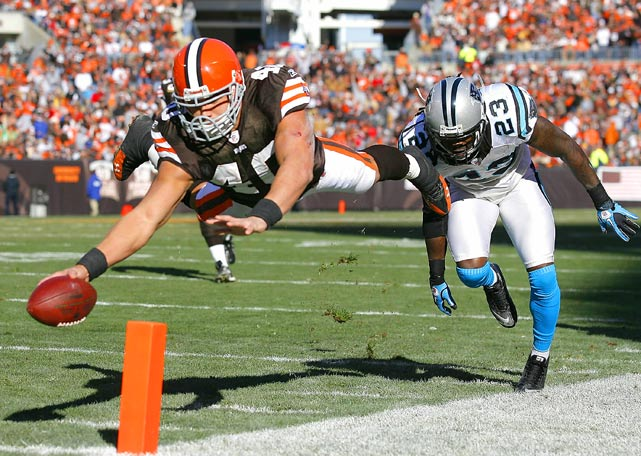 Running back Peyton Hillis of the Cleveland Browns scores a touchdown in front of safety Sherrod Martin of the Carolina Panthers on Nov. 28 in Cleveland. The Browns defeated the Panthers 24-23.