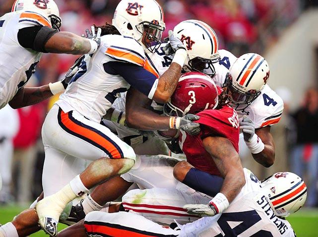 Auburn's defense stops Alabama running back Trent Richardson during the Iron Bowl at Bryant-Denny Stadium in Tuscaloosa. Auburn defeated Alabama 28-27.
