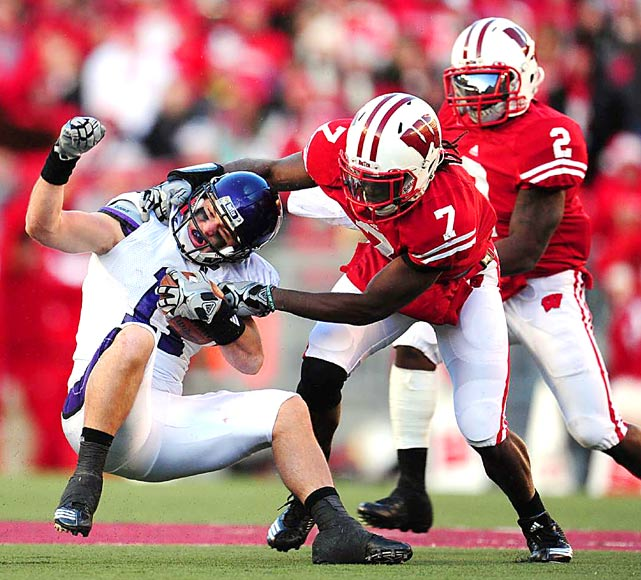 Northwestern wide receiver Jeremy Ebert is tackled by Wisconsin cornerback Aaron Henry during their Nov. 27 game at Camp Randall Stadium in Madison. Wisconsin defeated Northwestern 70-23.