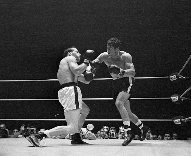 When Robinson retired for the first time, in December 1952, Olson ( right ) won a four-man tournament for the vacant middleweight title. He defeated Paddy Young before outpointing Randy Turpin at Madison Square Garden for the recognized lineal title.