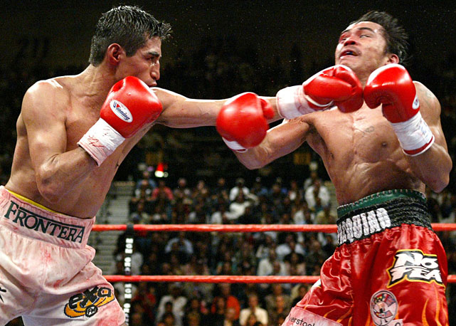 Moving up to super featherweight (130 pounds) for a showdown with Mexico's legendary three-division champion -- the first installment of an epic trilogy -- Pacquiao suffered a cut from an accidental butt in the fifth round and lost a unanimous decision.