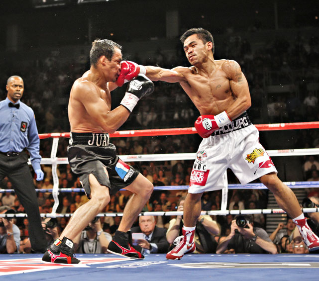 Fighting for the WBC super featherweight title (130 pounds), Pacquiao outpointed Marquez in a narrow decision -- a crucial third-round knockdown making the difference. The victory gave Pacquiao the world title in a fourth weight class.