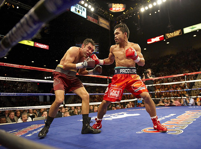 Pacquiao's transition from boxing notable to crossover superstar was crystallized with a dramatic ninth-round TKO of De La Hoya in a non-title fight at the MGM Grand Garden Arena in Las Vegas. While De La Hoya was considered past his prime, many believed the climb to the welterweight limit (147 pounds) would prove too imposing for Pacquiao. They were wrong. The Filipino peppered the Golden Boy all night long with punches from all angles, until De La Hoya quit on his stool after the eighth round ... and quit boxing shortly thereafter.