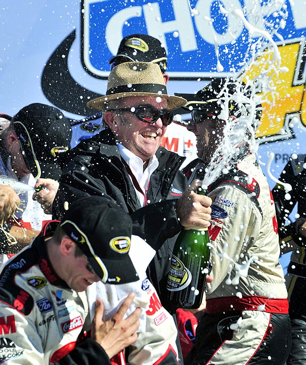 Greg Biffle commemorated owner Jack Roush's return to the race track following a second horrific plane crash with a win at Kansas. Roush had crashed his private plane at a small airport in Wisconsin in late July, losing his right eye and requiring facial surgery.