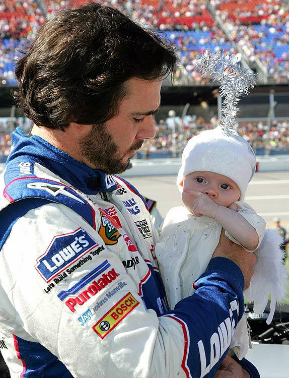 Points leader Jimmie Johnson holds daughter Genevieve Marie, dressed as an angel for Halloween, just before the start of Sunday's race.