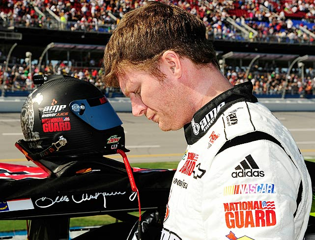 Dale Earnhardt Jr. stands alongside his No. 88 car before the start of the race. The race marked the 10-year anniversary of Dale Earnhardt's last career win before his untimely death.