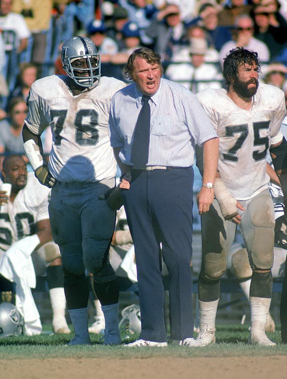 Longtime Raiders coach John Madden patrols the sideline as Art Shell (No. 78) and John Vella (No. 75) look on. In addition to being one of the best offensive linemen of his era, Shell also coached the Raiders twice. During the first stint (1989-94), Shell went 56-41 with three playoff appearances. The second stint (2006) was less successful (2-14) and he was let go after the season.