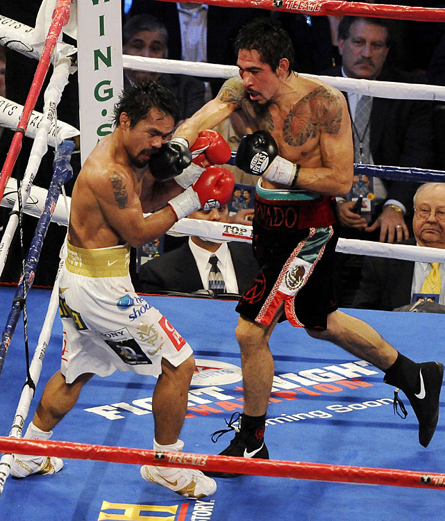 Every time Margarito landed a crisp shot, Pacquiao rushed to return fire -- and typically succeeded.