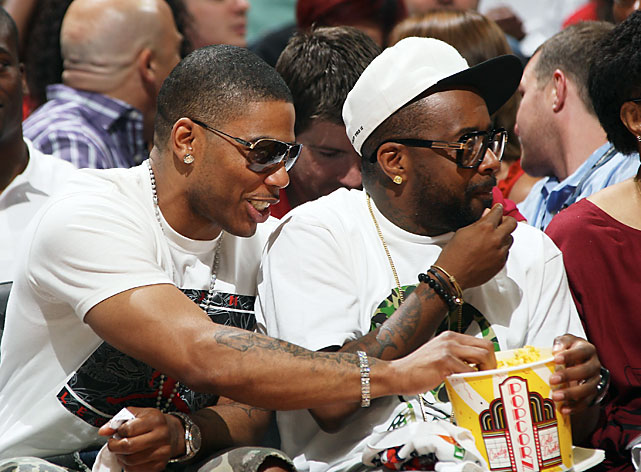 Essentially what we have here is a Hawks fan sharing popcorn with a Bobcats fan/owner. Um, is that allowed?
