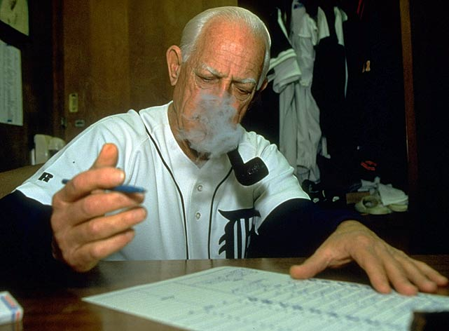 Anderson smokes a pipe and fills out the lineup card before a game against the Twins. Anderson managed 16 seasons with the Tigers, winning one World Series (1984) and two Manager of the Year awards (1984, '87).