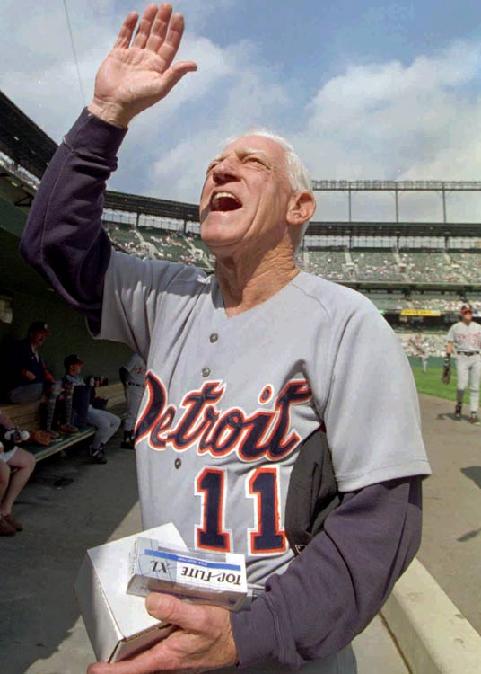 Clutching gifts presented to him before the game, Anderson waves to fans in the stands at Camden Yards during his last trip to Baltimore as the Tigers' manager.