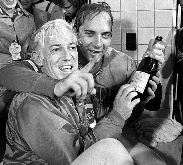 Anderson and catcher Johnny Bench share champagne in the visitor's locker room at Fenway Park after the Reds beat the Red Sox to win the World Series.
