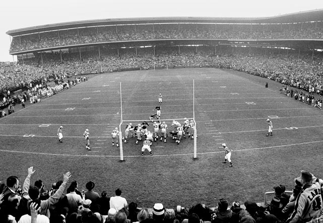 With both teams boasting identical 8-1 records, the Packers and Bears faced off in front of 49,166 fans at Wrigley Field on Nov. 17, 1963. The Bears outmatched Vince Lombardi's Packers squad, defeating Green Bay 26-7 in front of the home fans.