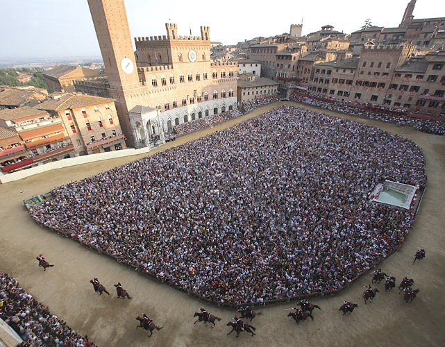 Horses and jockeys compete in a general practice of the Palio horse race on Piazza del Campo in Siena, Tuscany. The Palio races, which take place twice a year on July 2 and Aug. 16, are traditional horse races that started in 1656 and are dedicated to Virgin Mary and to Madonna of Provenzano.