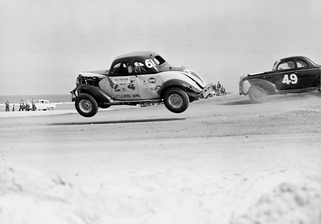 Before the Daytona International Speedway was built in 1959, NASCAR held its annual race on the four-mile Daytona Beach Road Course.