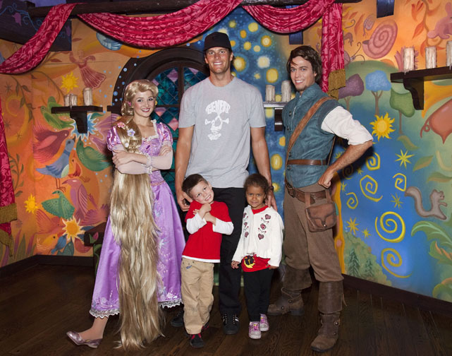 Brady, his son Jack and niece Jordan meet Rapunzel and Flynn Rider of Disney's animated film  Tangled  while celebrating Jordan's fifth birthday at Disneyland in Anaheim, Calif.