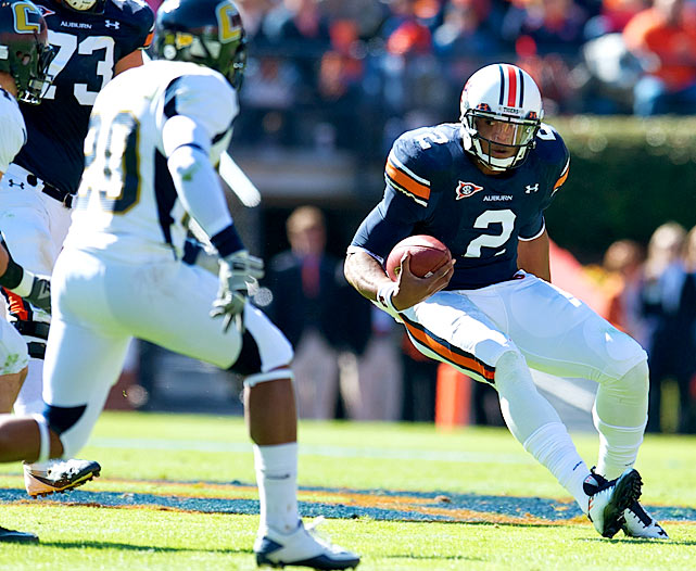 Off-field distractions couldn't slow Cam Newton -- and neither could the Chattanooga Mocs. Two days after allegations surfaced regarding Newton's recruitment, the Auburn star passed for a career-high 317 yards and four touchdowns and ran for a fifth -- all in the first half.