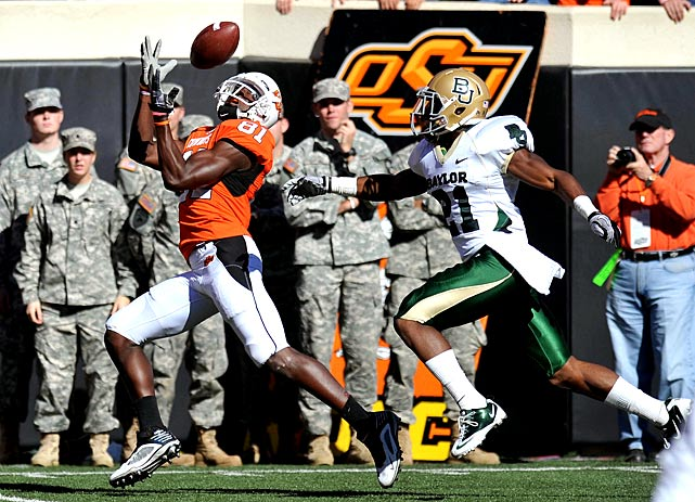 Who knows what would have happened if Baylor and Oklahoma State had played one week ago, when Cowboys receiver Justin Blackmon was serving a one-game suspension. Blackmon made his presence felt early and often Saturday, catching 13 passes for 173 yards and a touchdown and rushing for another score on a 69-yard end-around. It was Blackmon's eighth straight 100-yard receiving game -- and Oklahoma State's eighth win on the year.