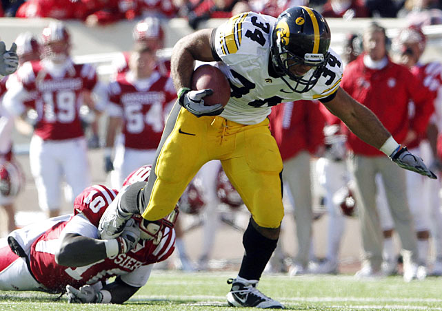 Iowa managed to keep pace with the Big Ten's other one-loss teams, but barely. The Hawkeyes managed just four field goals until quarterback Ricky Stanzi found a wide-open Marvin McNutt for a 52-yard go-ahead score with 2:50 remaining. Freshman running back Marcus Coker (pictured) helped Iowa keep pace until that play, rushing for 129 yards in place of the injured Adam Robinson.