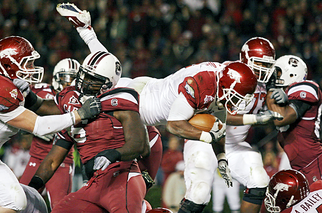Arkansas brought the country's second-best air attack and the league's top passer in Ryan Mallett into Williams-Brice. But Knile Davis (center) rushed for 110 yards and tied a career high with three touchdowns as Arkansas handed South Carolina its worst home loss in five years. South Carolina can still take the SEC East title and reach its first league title game by beating Florida at The Swamp next Saturday. However, the Gamecocks are 0-12 in Gainesville, Fla.