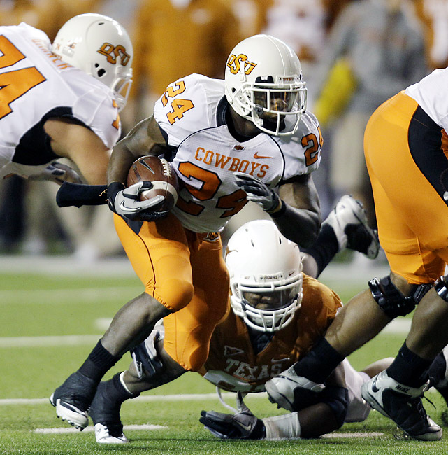Brandon Weeden passed for 409 yards and Kendall Hunter (center) rushed for 116 yards and two touchdowns as Oklahoma State ended a 12-year losing streak to Texas in resounding fashion. The win kept surging Oklahoma State (9-1, 5-1) in first place in the Big 12 South with two games to play. The Cowboys have never won the division. Justin Blackmon had 145 yards receiving for the Cowboys, including a 67-yard touchdown catch in the second quarter, his 16th of the season, the most in the nation.