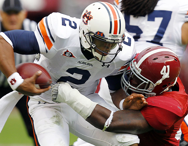 There's no question this was a tale of two halves. The host Tide (9-3 overall, 5-3 SEC) lead 21-0 before Auburn even picked up a first down and had a 314-2 lead in total yards at one point in the first half. But Cam Newton (left), delivering his signature performance in a season of controversy, rallied the Tigers (12-0, 8-0) for a victory, stunning the more than 101,000 Alabama fans in attendance and keeping Auburn on course for a shot at the national championship.