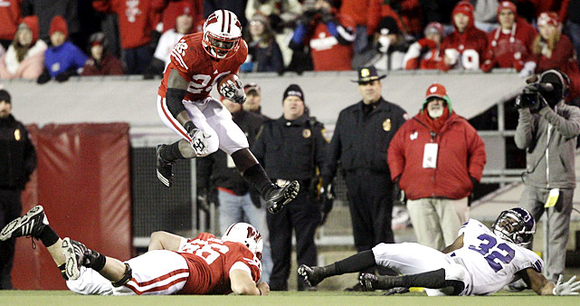 Big Ten foes should shudder at the thought of what Wisconsin running back Montee Ball will do next season. The sophomore rushed for 178 yards and four scores against Northwestern, his fourth straight game with 100-plus yards and multiple scores since stepping in for injured starter John Clay. The Badgers (11-1, 7-1 Big Ten) continued to roll as well, securing a share of the Big Ten title and likely wrapping up a Rose Bowl berth.