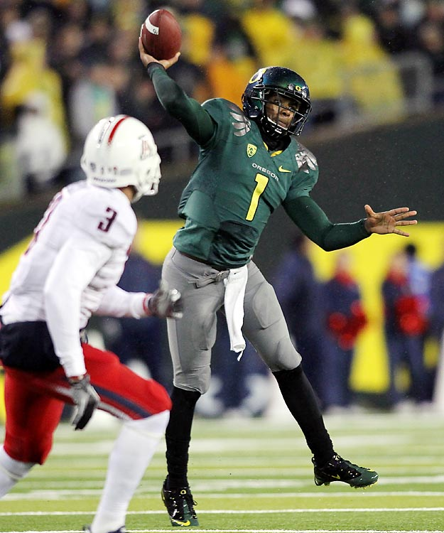 Darron Thomas passed for three touchdowns and ran for another and top-ranked Oregon earned at least a share of a second consecutive Pac-10 title. LaMichael James shrugged off talk of an injury to run for 126 yards and two scores for the Ducks (11-0 overall, 8-0 Pac-10), who trailed 19-14 at halftime but surged in the second half to stay on course for a trip to the BCS title game.