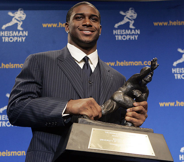 He was no Saint: The former Trojans running back became the first player ever to forfeit a Heisman Trophy after his alma-mater, USC, was hit with sanctions of four years' probation, a two-year bowl ban and loss of scholarships due to its NCAA rules violations during the 2005 season. Bush and his family allegedly accepted more than $100,000 in improper benefits from marketing agents.
