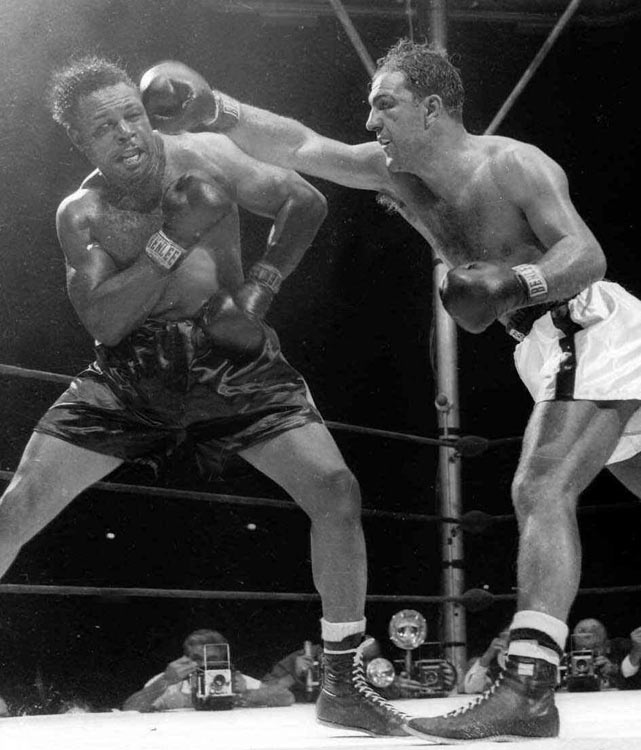 The late-blooming Moore (left), who holds the record for most career knockouts (131), won the light heavyweight crown at 39 with his 1952 victory over Joey Maxim and held the title long into his forties. His only two losses during the remainder of the decade came at heavyweight, when he moved up to fight Rocky Marciano and Floyd Patterson.