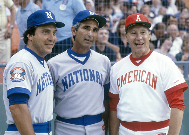 Johnny Bench, Sandy Koufax and Bob Feller in the National League and American League uniforms for the Cracker Jack Classic.