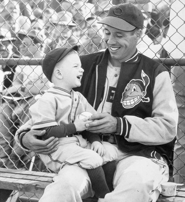 Bob Feller and a young Indians fan share a laugh before a game at Municipal Stadium in Cleveland. Feller remains one of the most popular players ever to don an Indian uniform.