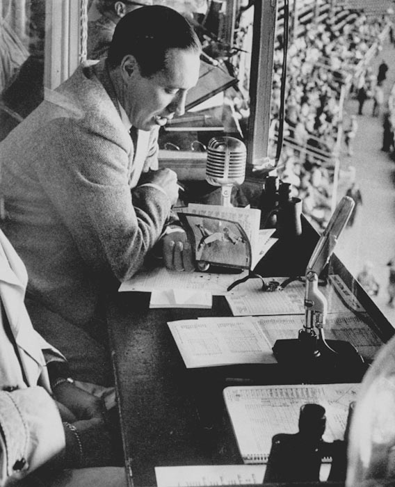 Feller takes in a game from the Wrigley Field Press Box.