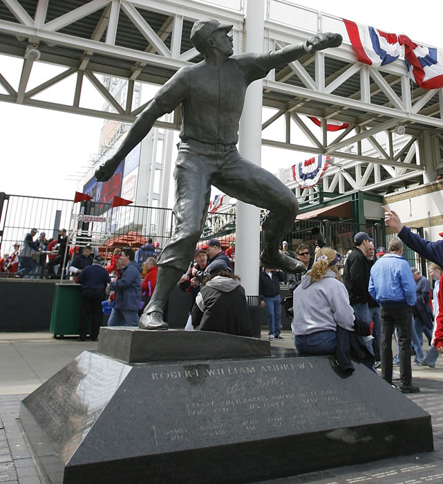 Visitors wait next to a statue of Bob Feller before the start of the Cleveland Indians Opening Day game. Up until his death, Feller was still part of the Indians, serving as an ambassador for the club in a variety of public-relations roles.