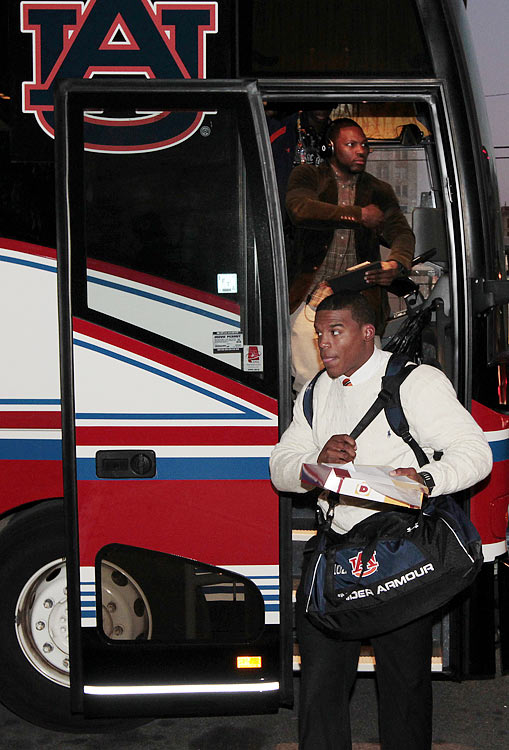 Newton steps off a bus as he arrives in Tuscaloosa for the annual Iron Bowl against Alabama. After trailing 24-7 at halftime, Auburn outscored its rival 21-3 in the second half to secure a 28-27 victory.