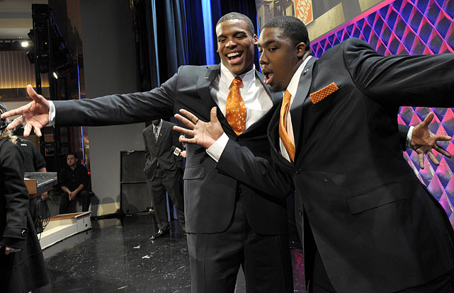 Newton jokes with teammate Nick Fairley after the Home Depot ESPNU College Football Awards on Dec. 9. Newton won the Davey O'Brien Award, given to the best quarterback, and the Maxwell Award, given to the best all-around player.  Fairley was a finalist for the Chuck Bednarik Award, given to the best defensive player.